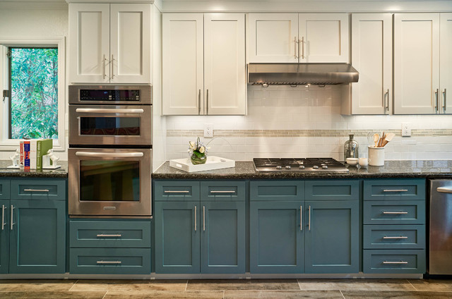 Kitchen cabinets Light uppers and dark lowers with granite countertop.