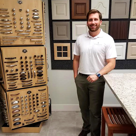 Paul Salter standing by cabinet and accessory options