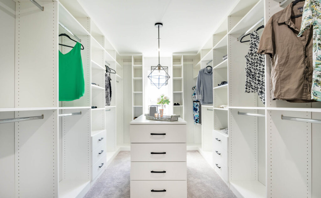 Custom built white walk-in closet